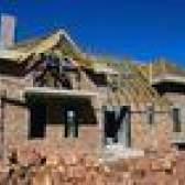 Início moldura de seguros vs. Custo tijolo