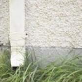 Quanto custa para estuque uma casa vs. O tapume do vinil?