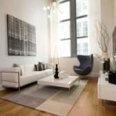 Como usar vários tapetes de área em um quarto