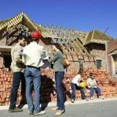 Qual é a diferença de custo entre o revestimento de vinil & bricking uma casa?
