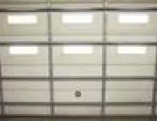 Como instalar dobradiças da porta da garagem