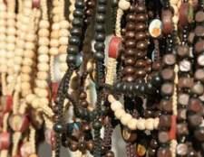 Como amarrar off jóia do grânulo com fio de nylon ou seda